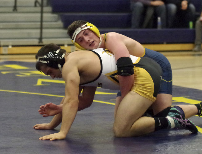 Eisenhower's Alex Barnett, shown wrestling against Iroquois' Joe Galvin in last week's dual, helped the Knights win Tuesday's match against North East with a pinfall victory in the final bout of the night.