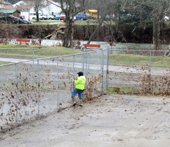 Photos submitted to Times Observer Youngsville Borough Employee Wayne Glasgow is repairing to Island Park Tennis Court and due to recent inclement weather.