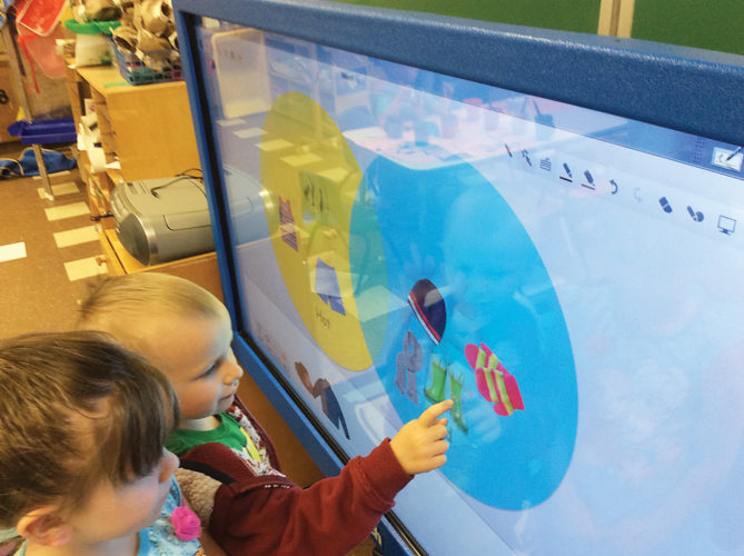 Photo submitted to Times Observer Head Start enrollees work with the smartboards that are installed in most Head Start classrooms throughout the county.