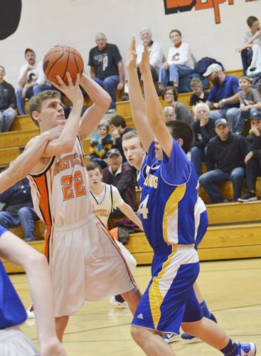 Sheffield's Drew Higby goes up for a shot over Johnsonburg's Ben Freeburg during the third quarter of Tuesday's senior night contest for the Wolverines. Higby finished with 14 points.