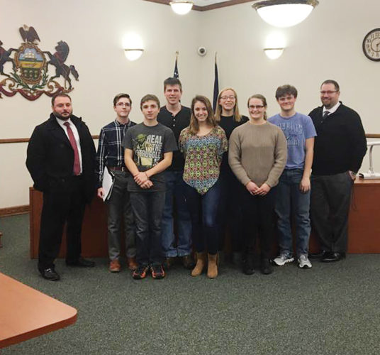 YHS Mock Trial team that completed in Erie last week includes, from left, Attorney Nick Milardo, Drake Ketchum, Dominick Walton, Jimmy Cowan, Elliyanna First, Greta Stoner, Rebekah Hogg, Mitchell Rex, and Attorney Cody Brown . Missing from the photo are Ethan Dyer and Paul Schwanke.