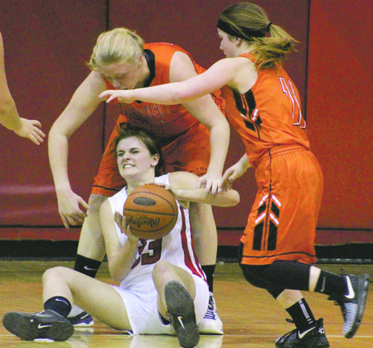 Youngsville's Julia Bailey looks for help while she fends off Sheffield's Ashley Fredrick (33) and Marissa Grubbs (11).