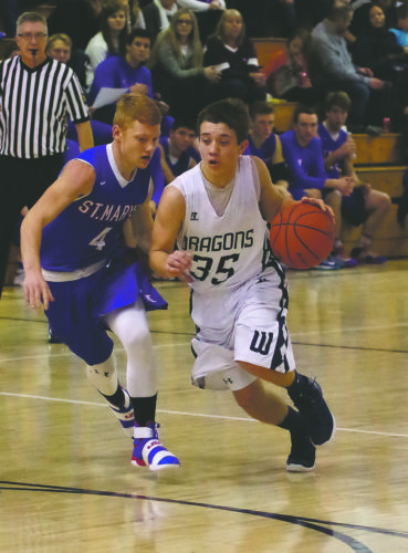 Warren sophomore point guard Griffin Suppa (35) and the Dragons will welcome Farrell to Joseph A. Massa Gymnasium in the first round of the District 10 4A playoffs tonight (7 p.m.).