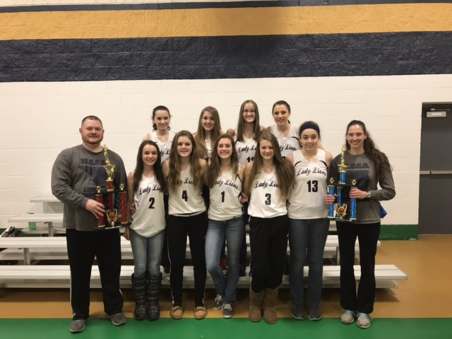 The New Penn Christian Conference Champion WCCS Lady Lions. From left to right, back row: Lilly Sabella, Lindsey Carpenter, McKenna Phelps, Kiara Baker. Front Row: Coach Robert Marrone, Grace Sabella, Emma Marino, Allie Marino, Desirae Kerr, coach Monica Kerr.