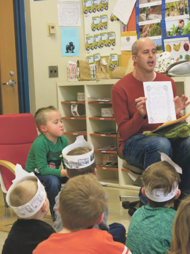 Times Observer photo by Stacey Gross Bentley Sherry (left) gets compliments from his classmates as Matt Menard explains why we give compliments.
