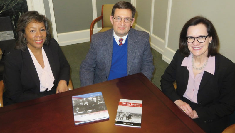 Photo submitted to Times Observer Marion Beckerink, left, director of development, and Susan Murphy, executive director, both of the Robert H. Jackson Center, met with John Lasher, center, executive director of the Community Foundation of Warren County, to discuss the distribution of the book, Off the Pedestal, to Warren County School District 10th-grade students as part of Robert H. Jackson Day in Warren.