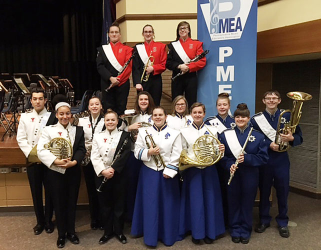 Photo submitted to Times Observer Warren County School District participants for Pennsylvania Music Educators Association (PEMA) District Band included, from left, in front, Lauryn Harshaw, Jessica Mack, Mikki Gifford, Grace Larson, and Brittany Darr, middle row, Corry McCoy, Greta Stoner Lydia Giannini, Ana Carlton, Hope Colvin,  and Parker Neal and, standing on stage in orange and black, Jasmine Brown, Destiny Wynn, and Madison Finch. Students represented Youngsville, Eisenhower, Warren and Sheffield high schools.