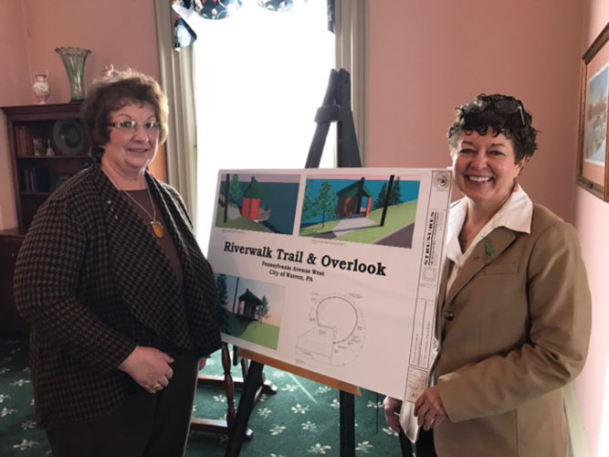 Photo submitted to Times Observer Josie Gerardi, Street Landscape committee member, is shown with Warren Woman's Club president Karen Davis during the recent presentation:  Urban Forest of Warren: Past, Present and Future.