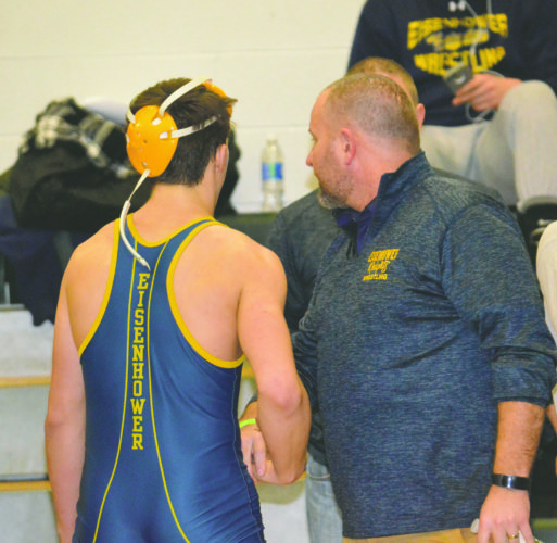 Eisenhower's Spencer Head (left) and coach Kris Black will be heading to the Northwest Region Class 2A Tournament today and Saturday, where Head will compete in the 152-pound weight class.