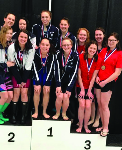 The Warren girls 200 medley relay team (middle) of Paige McCullough, Cara Anderson, Gabby Hahn and Lydia Latimer won the District 10 title at the SPIRE Institute in Geneva, OH.