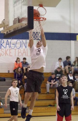 Warren senior Braidy Blair throws down a dunk during the fourth quarter of Wednesday's CASA Classic basketball game at Warren Area High School.