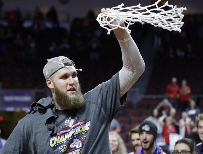 Gonzaga's Przemek Karnowski (24) cuts down the net after defeating Saint Mary's in an NCAA college basketball game during the championship of the West Coast Conference tournament, Tuesday, March 7, 2017, in Las Vegas. Gonzaga won 74-56. (AP Photo/John Locher)