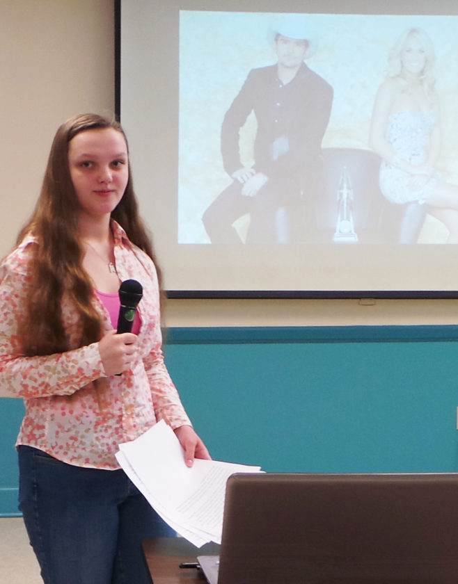 Photos submitted to Times Observer Using a slideshow to illustrate the greatness of Country Music and Guitars, Melissa Bennett earned a blue ribbon at the 29th Annual Kiwanis 4-H Presentations program.