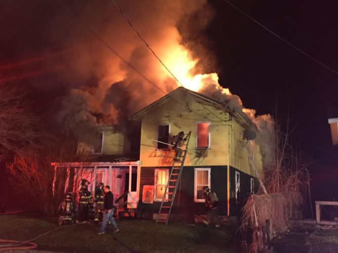 Post Journal photo by Eric Tichy Firefighters on West 10th Street in Jamestown. The fire was reported after 2 a.m., the fourth such structure fire in a three-hour span.