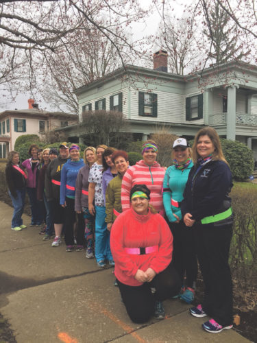 (Photo by Martha Rogus) Running Revolution's walking group was out enjoying a warmer evening Tuesday, with youthful vigor. They happily stopped along East Street for this photo opp.