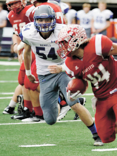 T-R PHOTO BY ADAM RING • Gladbrook-Reinbeck senior linebacker Thomas Mussig (54) pursues St. Ansgar fullback Parker Hendrickson (44) during the Class A state semifinal football game Nov. 11 at the UNI-Dome in Cedar Falls. Mussig finished fourth in Class A in total tackles en route to being named first-team all-state by the Iowa Newspaper Association.