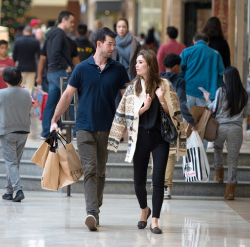AP PHOTO In this Nov. 25, file photo, Eric Denker and his wife, Jalen Denker, of Irvine, take advantage of sales to buy suits for business school interviews at South Coast Plaza in Costa Mesa, Calif. On Friday, the U.S. government issued the November jobs report.