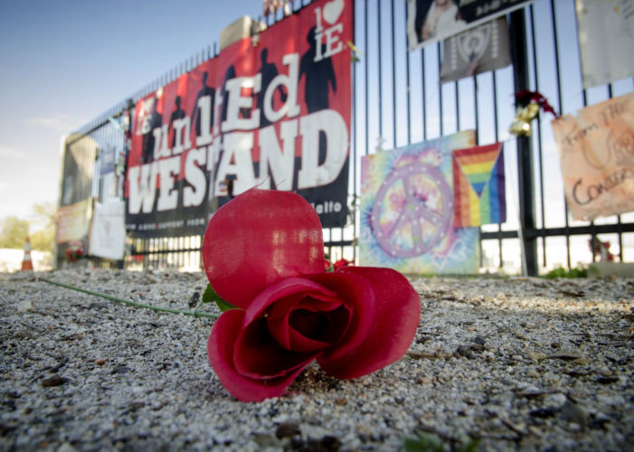 AP PHOTO This Thursday, photo shows an artificial flower in front of a memorial at the Inland Regional Center, the site of last year's terror attack, in San Bernardino, Calif. Friday marked the one year anniversary of the attack.