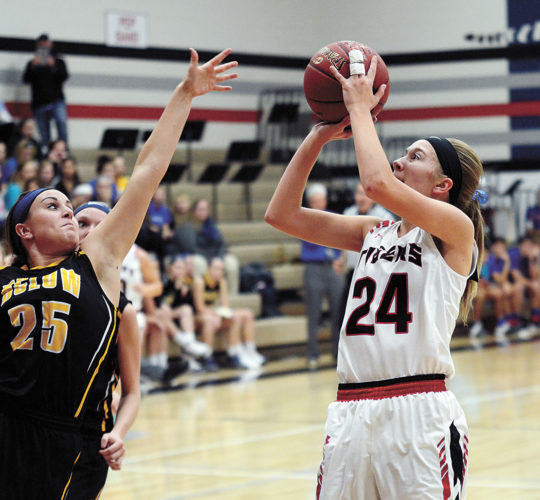 T-R PHOTO BY STEPHEN KOENIGSFELD South Hardin's Kiera Anderson (24) shoots over BCLUW's Kate Goecke (25) on Friday night. The Tigers won 54-50. Anderson finished with two points.