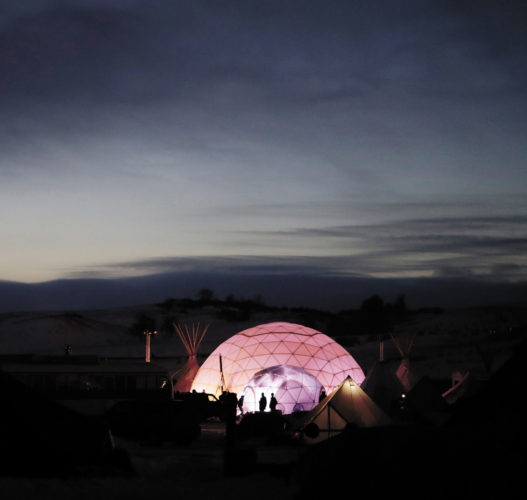 AP PHOTO People stand outside a dome used as a community center and sleeping area at the Oceti Sakowin camp where people have gathered to protest the Dakota Access oil pipeline in Cannon Ball, N.D., Friday.