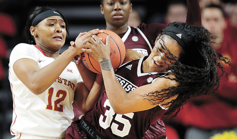 AP PHOTO • Mississippi State forward Victoria Vivians (35) fights for a loose ball with Iowa State guard Seanna Johnson (12) during the first half of an NCAA college basketball game, Saturday in Ames.