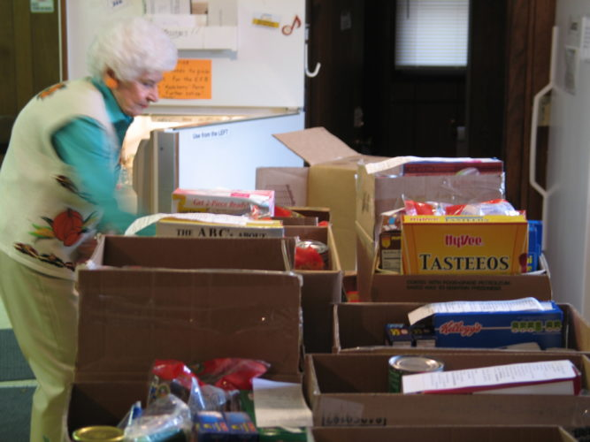 T-R FILE PHOTO A Marshalltown Emergency Food Box volunteer is shown organizing boxed and canned items in this undated file photo. Donations of foodstuffs to the Food Box are especially welcome during the Christmas season, as many needy individuals and families struggle to make ends meet.