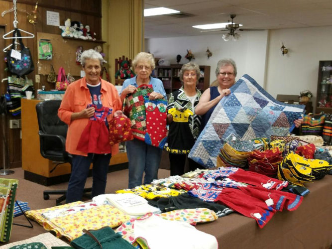 CONTRIBUTED PHOTO From left, Joan Stevens, Mary Isaacson, Pat Hornber, and Leanna Bowers show off some of the many crafts made at the Marshalltown Senior Citizens Center.