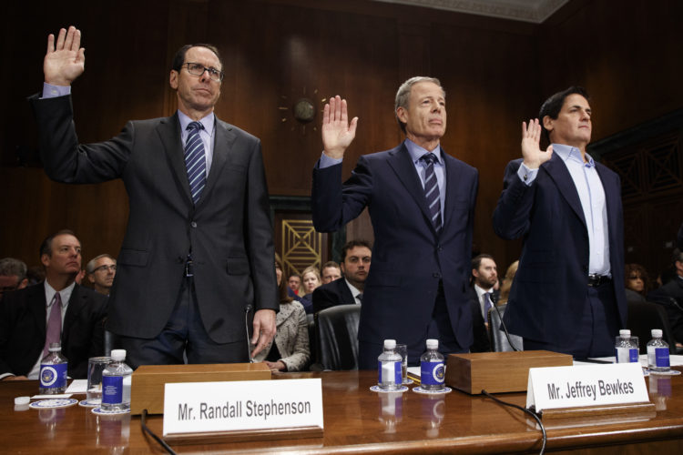 AP PHOTO From left, AT&T Chairman and CEO Randall Stephenson, Time Warner Chairman and CEO Jeffrey Bewkes, and AXS TV Chairman and Dallas Mavericks owner Mark Cuban are sworn in on Capitol Hill in Washington, Wednesday, prior to testifying before a Senate Judiciary subcommittee hearing on the proposed merger between AT&T and Time Warner.