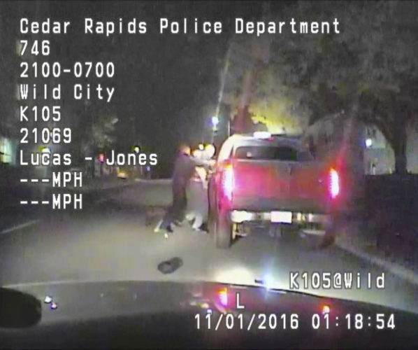 AP PHOTO In this image made from a Nov. 1, dashcam video released Thursday, by Cedar Rapids Police Department, an unarmed black motorist struggles with an Iowa officer and a police dog before the driver is shot and paralyzed.