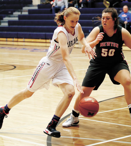 T-R PHOTO BY ADAM RING • Marshalltown's Kassy Vest drives toward the basket against Newton's Ali Bestell (50) Thursday at the Roundhouse. Vest led all scorers with 14 points, but Newton came away with the 45-38 win.