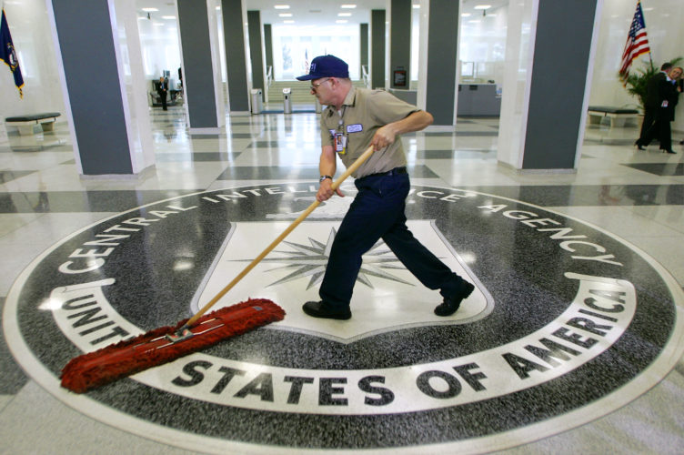 FILE - In this March 3, 2005 file photo, a workman slides a dustmop over the floor at the Central Intelligence Agency headquarters in Langley, Va. President Barack Obama has ordered intelligence officials to conduct a broad review of election-season cyberattacks, including the email hacks that rattled the presidential campaign and raised fresh concerns about Russia's meddling in U.S. elections, the White House said Friday. (AP Photo/J. Scott Applewhite)
