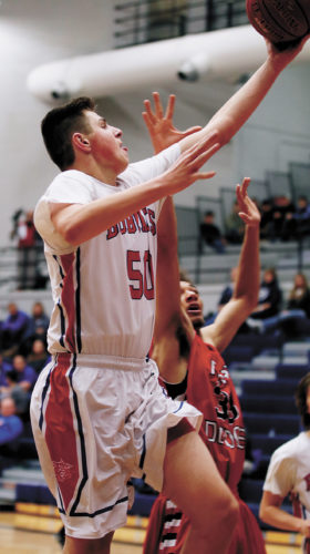 T-R PHOTO BY ADAM RING • Marshalltown's Luke Appel goes for a layup in the second half against Fort Dodge Friday night at the Roundhouse. Appel scored 17 points, but the Bobcats fell 54-30.