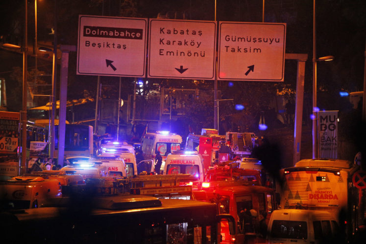 AP PHOTO Rescue services rush to the scene of explosions near the Besiktas football club stadium, following at attack in Istanbul, late Saturday.