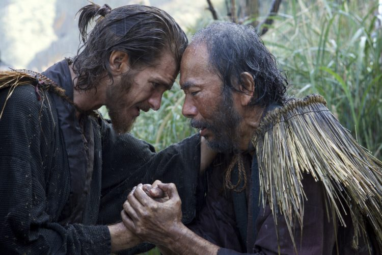 """AP PHOTO This image released by Paramount Pictures shows Andrew Garfield, left, and Shinya Tsukamoto in a scene from """"Silence."""""""