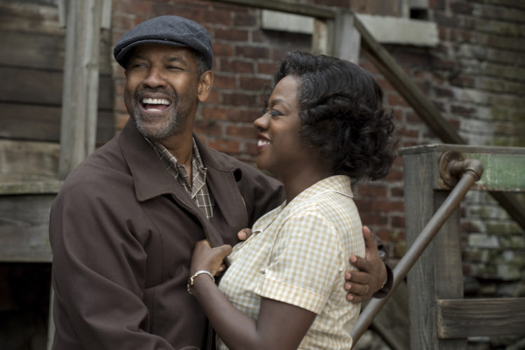 """AP PHOTO This image released by Paramount Pictures shows Denzel Washington, left, and Viola Davis in a scene from, """"Fences."""""""