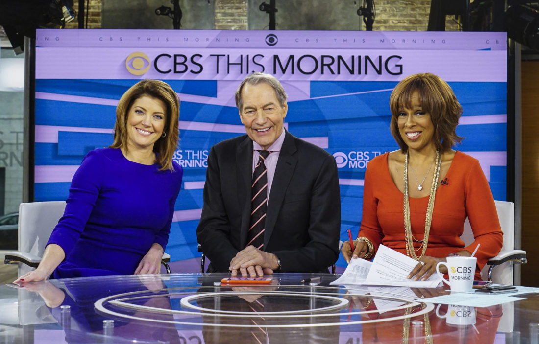 "AP PHOTO This Dec. 7, 2016 image released by CBS shows, from left, Norah O'Donnell, Charlie Rose and Gayle King on the set of ""CBS This Morning,"" in New York."
