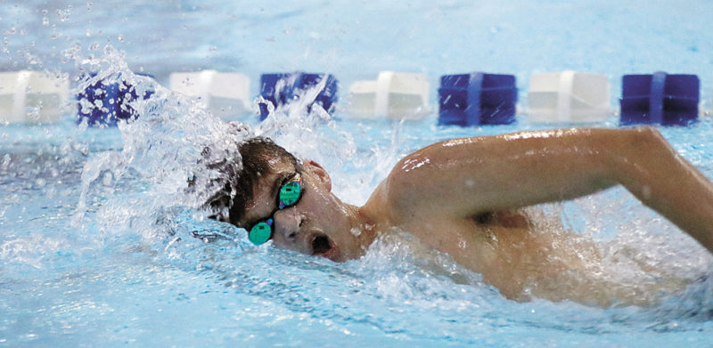 T-R PHOTO BY ADAM RING • Marshalltown swimmer Gage Petty swims a length of the 200-yard freestyle against Mason City on Thursday at Marshalltown High School. Petty won the race in 1 minute, 57.15 seconds, setting a season-best time in the process, but Mason City topped the Bobcats 92-78.