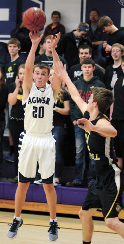 T-R PHOTO BY STEPHEN KOENIGSFELD • AGWSR's Alex Hames shoots a 3-pointer over West Marshall's Cameron Bannister during Friday night's NICL West Division game in Ackley. Hames made one 3-pointer in the Cougars 60-57 win.
