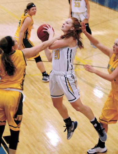 T-R PHOTO BY ADAM RING • Marshalltown Community College basketball player Alyssa Roth (20) is fouled by John Wood CC's Kaley Augspurg in the first quarter at the Student Activity Center in Marshalltown. Roth tied a career-high with 19 points, but MCC came up short, falling 60-56.