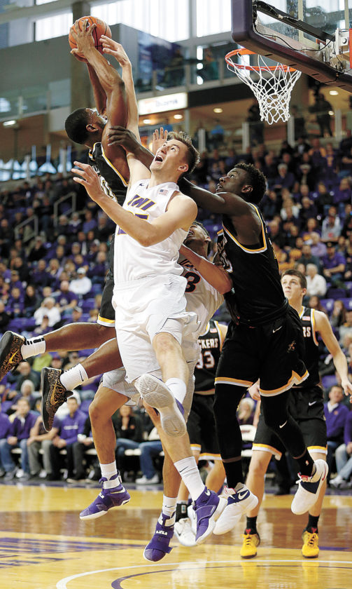 AP PHOTO • Northern Iowa's Bennett Koch fights for a rebound against Wichita State's Rashard Kelly, left, and Eric Hamilton, right, during the first half of a Missouri Valley Conference basketball game Sunday at the McLeod Center in Cedar Falls.