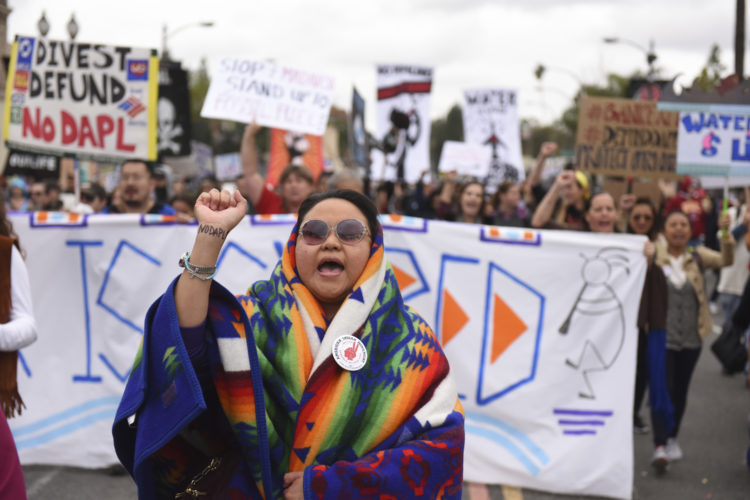 AP PHOTO In this Jan. 2, file photo, protesters rally against the Dakota Access Pipeline behind the 128th Rose Parade in Pasadena, Calif.