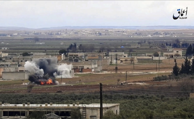 AP PHOTO This image made from militant video posted online by the Aamaq News Agency, a media arm of the Islamic State group on Monday, purports to show the moment of a Turkish missile strike, in the northern Syrian town of al-Bab, in Aleppo province, Syria.