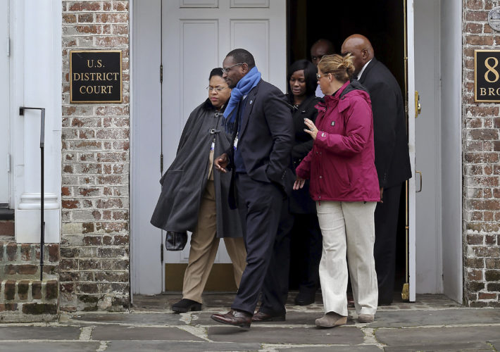 AP PHOTO Jennifer Pinckney, widow of the Rev. Clementa Pinckney, one of the Emanuel Church shooting victims, leaves the U.S. District Court with family friend Kylon Middleton on Tuesday, in Charleston, S.C.