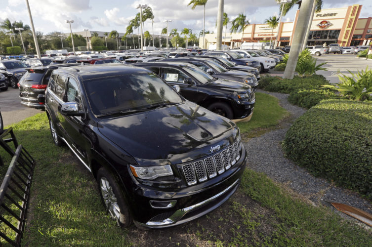AP PHOTO In this Thursday, Nov. 5, 2015, file photo, 2015 Jeep Grand Cherokees appear on display at a Fiat Chrysler dealership in Doral, Fla. On Thursday, the U.S. government alleged that Fiat Chrysler Automobiles failed to disclose that software in some of its pickups and SUVs with diesel engines allows them to emit more pollution than allowed under the Clean Air Act.