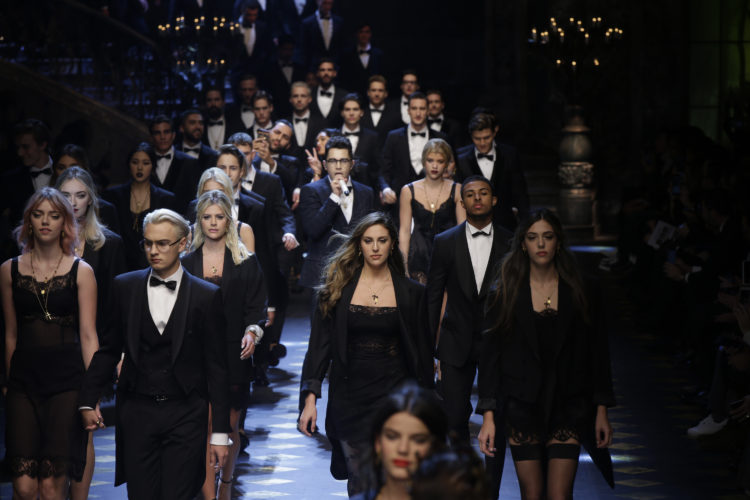 AP PHOTO Models wear creations for Dolce & Gabbana men's Fall-Winter 2017-2018 collection, part of the Milan Fashion Week, unveiled in Milan, Italy, Saturday.