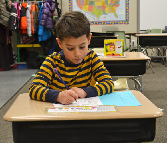 T-R PHOTO BY SARA JORDAN-HEINTZ Gavin Rodregez, 7, is a studious first grader at Marshalltown Christian School. He likes to sing, read, bowl and play soccer. He would like to be a firefighter when he grows up.