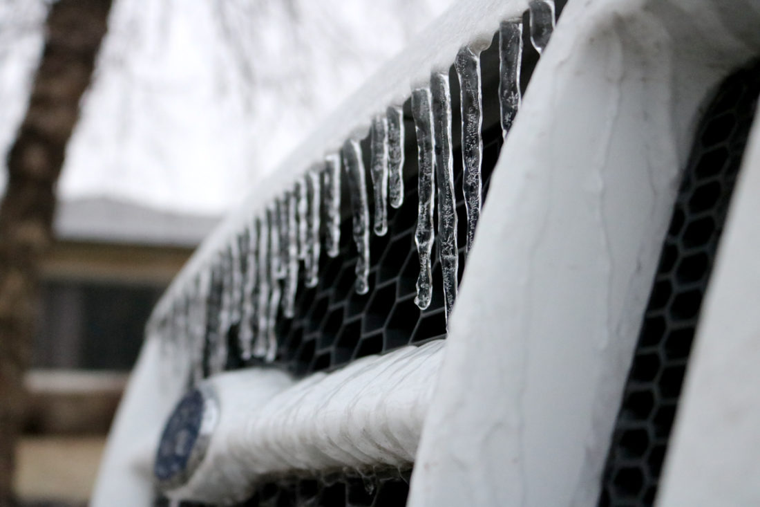 Many central Iowans got into their ice-coated cars to brave the roadways Monday morning after a night of freezing rain. Icicles could be seen dangling off of vehicles, overhangs and a myriad of other services across the state.
