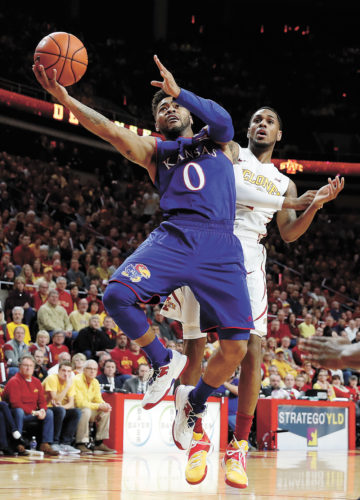 AP PHOTO • Kansas guard Frank Mason III (0) drives to the basket past Iowa State guard Monte Morris during the first half of a Big 12 Conference basketball game Monday inside Hilton Coliseum in Ames. Mason scored a team-leading 16 points as No. 2 Kansas won 76-72.