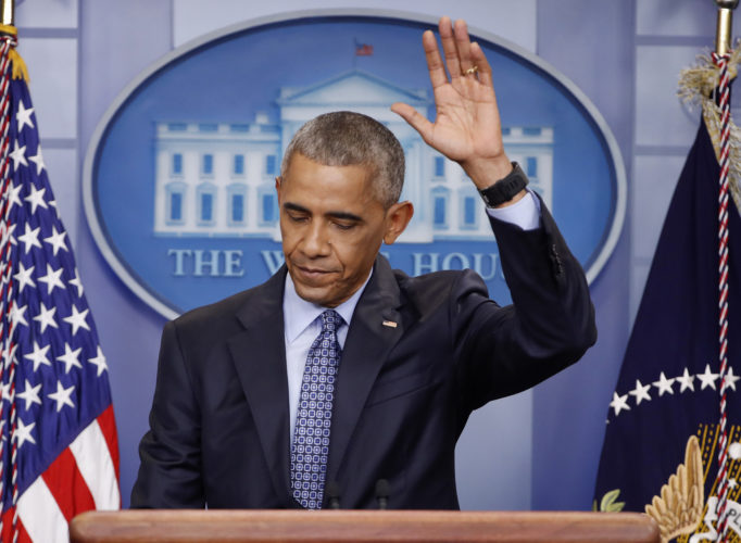 AP PHOTO President Barack Obama waves at the conclusion of his final presidential news conference, Wednesday,  in the briefing room of the white House in Washington.