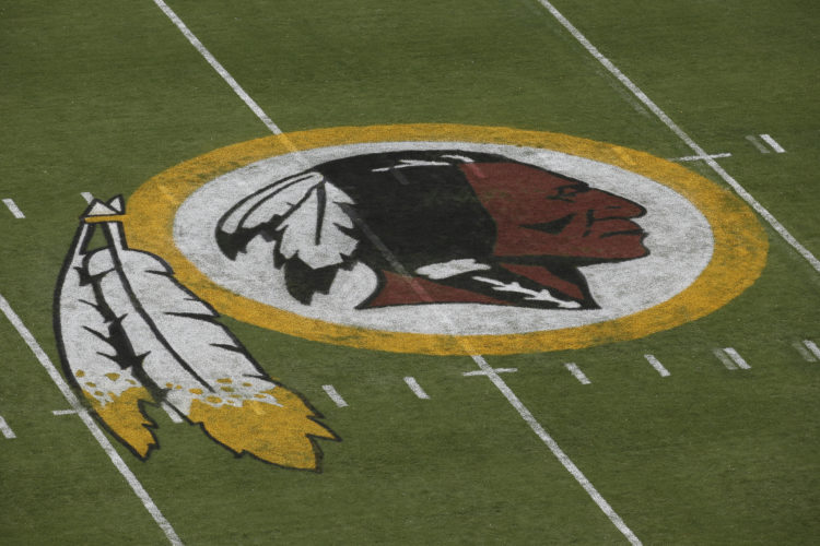 AP PHOTO In this Aug. 7, 2014 file photo, the Washington Redskins logo is seen on the field before an NFL football preseason game against the New England Patriots in Landover, Md. The Supreme Court is expressing doubts about a law that bars the government from registering trademarks that are deemed offensive.